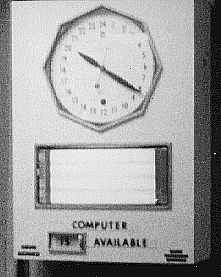 24-hour clock and Computer Is Available sign